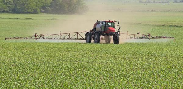 Sprayer applying a pesticide to a field.