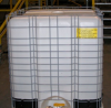 Caged pesticide tank